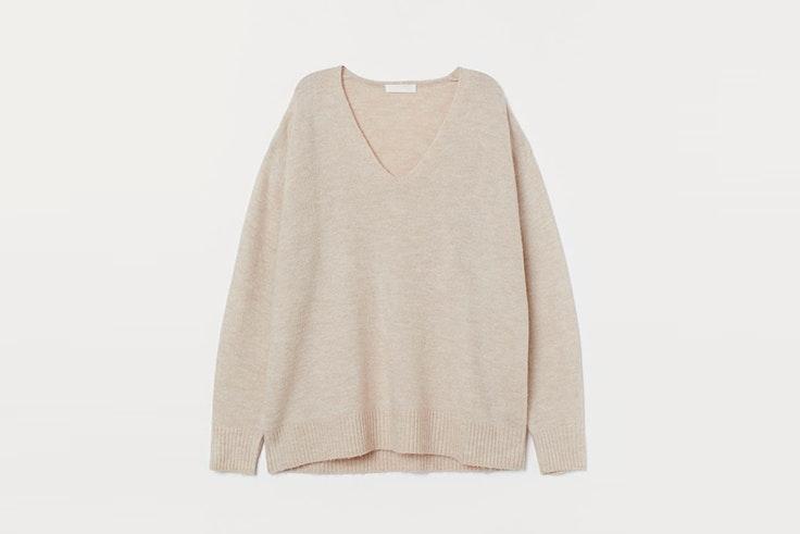 Jersey con escote de pico en color beige de H&M