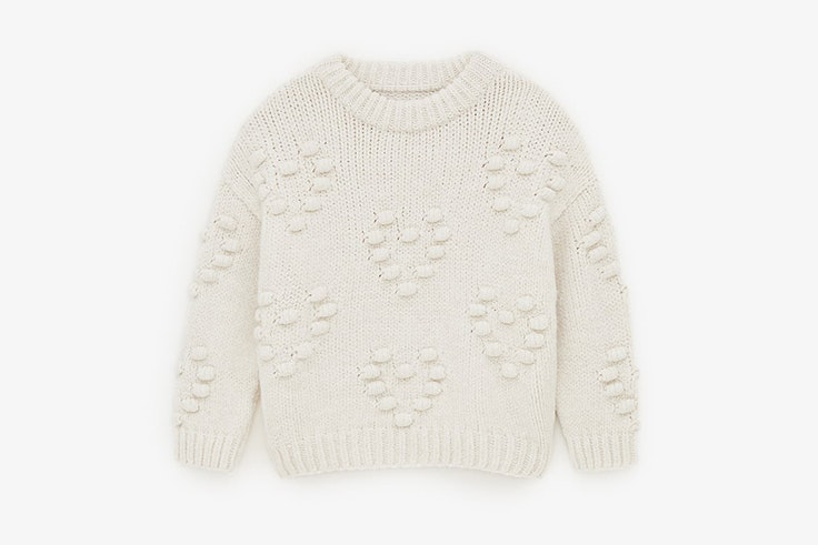 Jersey de punto en color beige con corazones de Zara